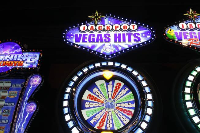 A Vegas Hits slot machine by Bally Technologies is displayed in the company's showroom Thursday, March 29, 2012.