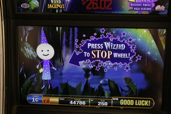 A screen is displayed on a Cash Wizard video slot machine by Bally Technologies is displayed in the company's showroom Thursday, March 29, 2012.