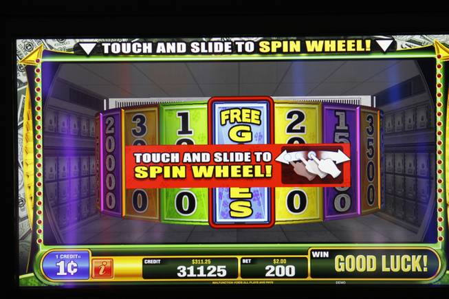 A screen displays a wheel on a Money Vault video slot machine by Bally Technologies Thursday, March 29, 2012.