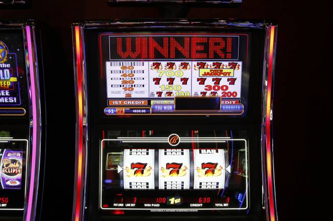 A Blazing Sevens slot machine by Bally Technologies is displayed in the company's showroom Thursday, March 29, 2012.