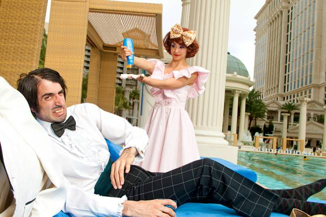 "The Gazillionaire and Penny Pibbets from ""Absinthe"" lounge at the pool at Caesars Palace."