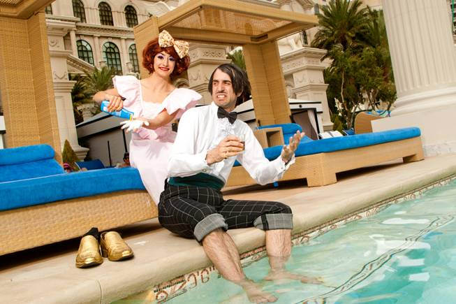 "The Gazillionaire and Penny Pibbets from ""Absinthe"" lounging at the pool at Caesars Palace."