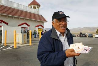 Reinaldo Nunley, a Greyhound bus driver, displays his 56 Mega Millions lottery tickets at the Primm Valley Lotto Store across the state line at Primm Thursday, March 29, 2012. Nunley said he bought 56 tickets because 56 is a lucky number for him.