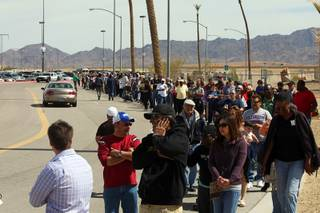 People wait in line to buy Mega Millions lottery tickets at the Primm Valley Lotto Store across the state line at Primm Thursday, March 29, 2012.