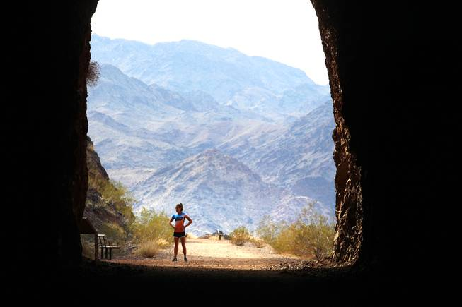 Candace Jones runs through the tunnels to Hoover Dam near Boulder City on Friday, March 30, 2012.