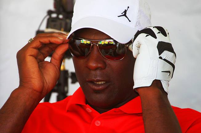 Michael Jordan adjusts his sunglasses at the Michael Jordan Invitational March 30, 2012, at Shadow Creek.