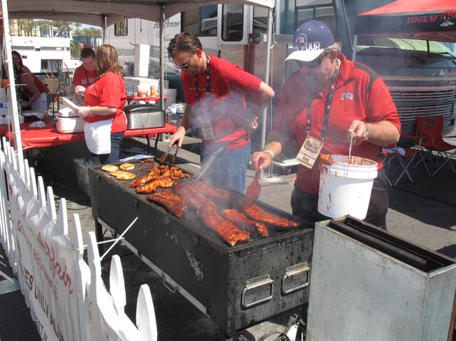 Competitors prepare ribs and chicken as part of the BBQ Throwdown challenge at Mandalay Bay Saturday. The competition was part of the Academy of Country Music Experience, which took over Mandalay's Bay convention center this weekend for three days of shopping, music and food.