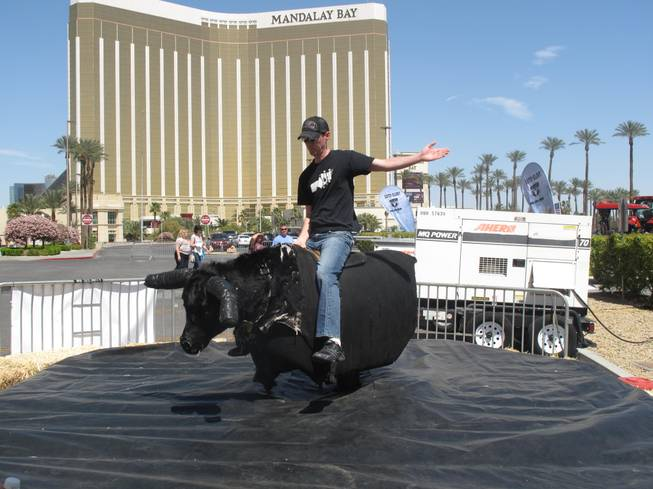 Patrick O'Connell, who was visiting Las Vegas from Canada, rides a mechanical bull during the Academy of Country Music Experience. The event, which took over the Mandalay Bay convention center, runs through Sunday and offers fans a chance to shop, eat and listen to live country music.