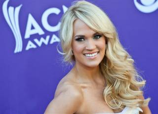 Carrie Underwood arrives at the 47th Annual Academy of Country Music Awards at MGM Grand Garden Arena on Sunday, April 1, 2012.