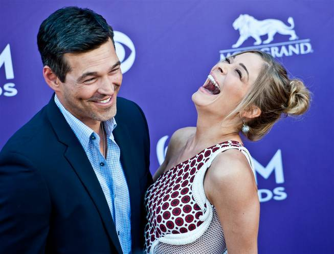 Eddie Cibrian and LeAnn Rimes arrive at the 47th Annual Academy of Country Music Awards at MGM Grand Garden Arena on Sunday, April 1, 2012.