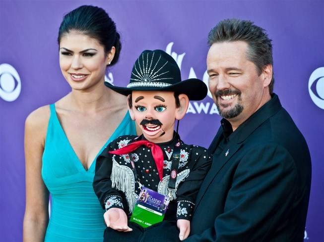 Taylor Makakoa, Walter T. Airedale and Terry Fator arrive at the 47th Annual Academy of Country Music Awards at MGM Grand Garden Arena on Sunday, April 1, 2012.