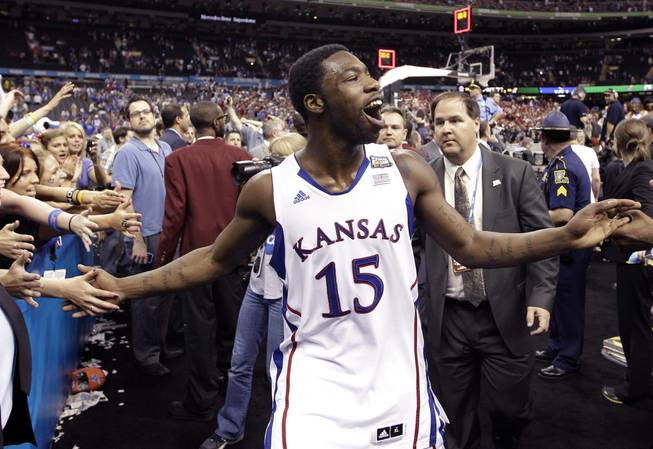 Kansas guard Elijah Johnson (15) celebrates after their 64-62 win over Ohio State in an NCAA Final Four semifinal college basketball tournament game Saturday, March 31, 2012, in New Orleans.