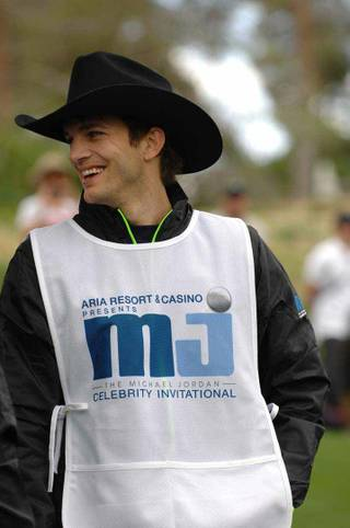 Ashton Kutcher serves as Michael Jordan's caddy at Shadow Creek Golf Course on Sunday, April 1, 2012.