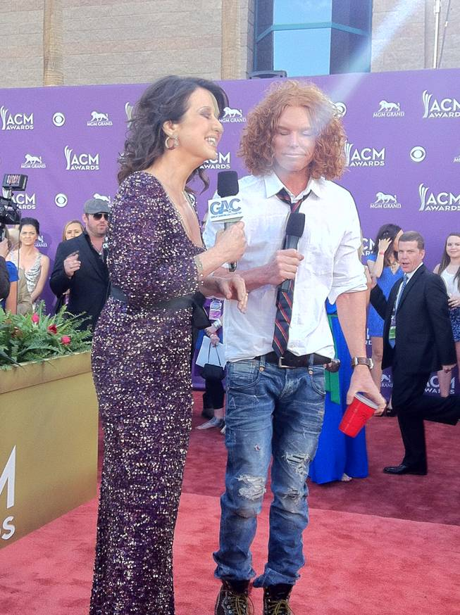 Carrot Top, contemplating an answer on the 2012 ACM Awards red carpet. The guy in the background is his publicist, Steve Flynn.