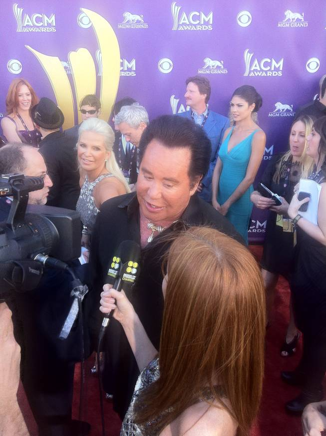 Wayne Newton on the 47th Annual ACM Awards red carpet at MGM Grand Garden Arena on Sunday, April 1, 2012. The beauty to his right is his wife, Kathleen.