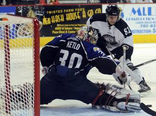 ECHL Second Team All-Star Adam Miller (81) is foiled by the outstretched pad of Colorado goaltender Damien Ketlo during the third period on Saturday night.