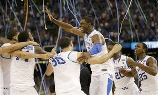 Kentucky's Terrence Jones, center, celebrates with teammates after the NCAA Final Four tournament college basketball championship game against Kansas Monday, April 2, 2012, in New Orleans. Kentucky won 67-59.