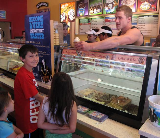 Chippendale Kyle Efthemes serves free cones at Ben & Jerry's at The District. It was free-cone day to celebrate the company's 34th anniversary. Donations benefited St. Jude's Ranch for Children in Boulder City.