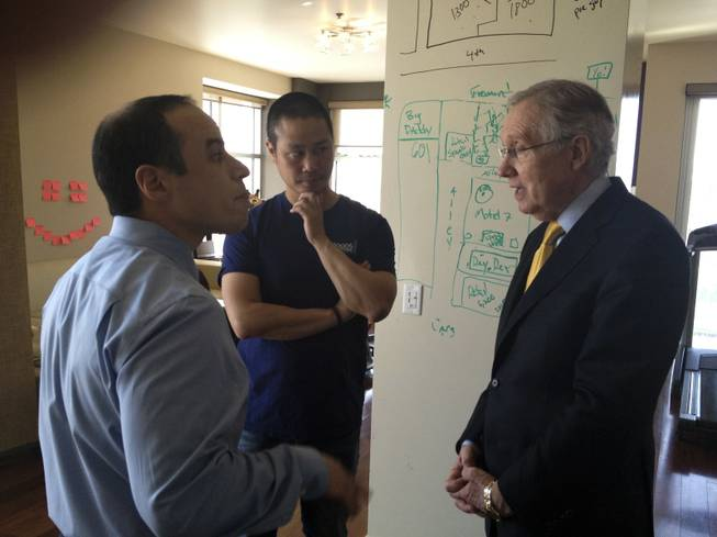 Dr. Zubin Damania, M.D., Tony Hsieh, and U.S. Sen. Harry Reid discuss the health system in Nevada in Hsieh's condo inside The Ogden in downtown Las Vegas.