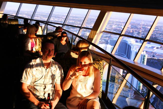Phil and Viv Ryder of Manchester, England enjoy two-for-one martinis and beers at Level 107 Lounge at the Stratosphere on Thursday, April 5, 2012.