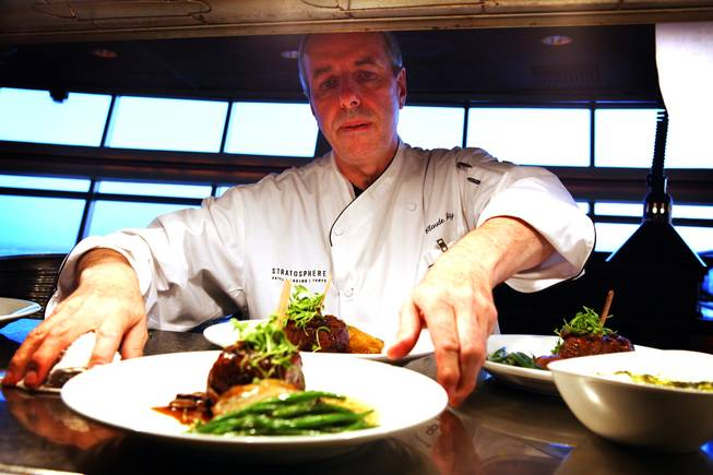 Chef Claude Gaty prepares a dish for service at the Top of the World Restaurant at the Stratosphere on Thursday, April 5, 2012.