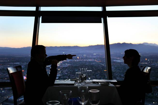 Diners enjoy the view from the Top of the World Restaurant at the Stratosphere on Thursday, April 5, 2012.