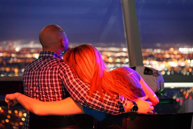 People enjoy the view from the Observation Deck at the Stratosphere on Thursday, April 5, 2012.