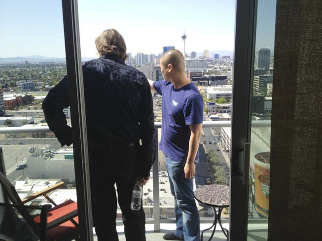 From his 23rd floor condo, Tony Hsieh points out various targets of redevelopment for his Downtown Project, a $350 million, multi-year endeavor, to Ed Lantz, CEO of Vortex Immersion Media.