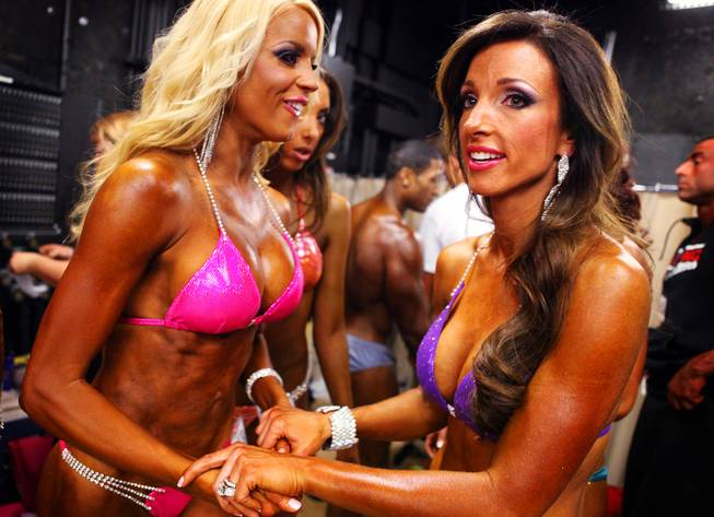 Dee's Divas Ruth Gray, left, and April Swartz, both of Las Vegas, wait to walk the stage in the bikini comeptition during the Jay Cutler Desert Classic at the Palms on Saturday, April 7, 2012.