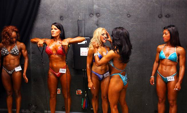 Figure competitors wait to take the stage during the Jay Cutler Desert Classic at the Palms on Saturday, April 7, 2012.