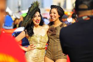 Women pose for photos at the Viva Las Vegas rockabilly weekend Saturday, April 7, 2012.