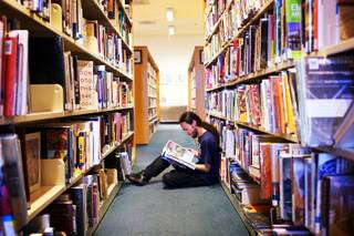 Matt Dakuginow, 23, reads a copy of Las Vegas Weekly at Green Valley Library in Henderson on Tuesday, April 10, 2012.