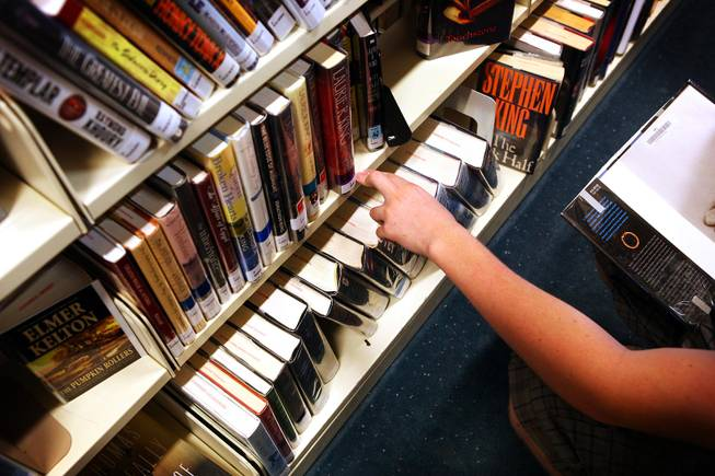 Parker Krebs, 16, of North Las Vegas checks out the selection of books at Green Valley Library in Henderson on Tuesday, April 10, 2012.