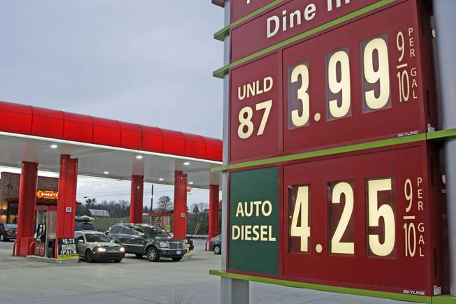 Gas prices are posted at a gas station in Breezewood, Pa., Monday, April 9, 2012. Gasoline prices in the U.S. fell by about a penny over the weekend to $3.927 per gallon. In Nevada, the average was $3.97.