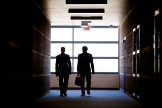 Joe Barison, right, the regional director of the U.S. Department of Education's Office of Communications and Outreach, tours Mojave High School campus with principal Antonio Rael in North Las Vegas on Thursday, April 12, 2012.