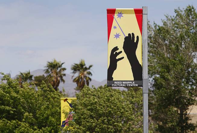"Banners are shown along Las Vegas Boulevard North Thursday, April 11, 2012. ""Pole Dancers,"" created by Las Vegas artist Martin Kreloff, is one of three pieces of art in the Cultural Corridor Trail Improvement Project, which won the Public Art Category award."