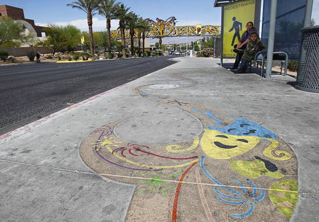 "A sidewalk enhancement is shown on Las Vegas Boulevard North Thursday, April 11, 2012.  ""Flourish,"" created by Las Vegas artist Denise Duarte, is one of three pieces of art in the Cultural Corridor Trail Improvement Project, which won the Public Art Category award. Flourish consists of eight sidewalk enhancements that coincide with banners and entice pedestrians and vehicles to follow the trail to individual cultural institutions."