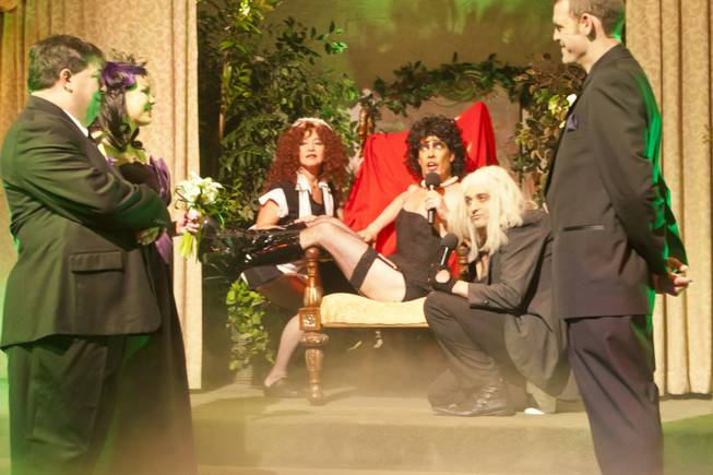 "Dr. Frank N. Furter, played by Ron DeCar, sings during the opening ceremony of a ""Rocky Horror"" themed wedding at Viva Las Vegas Wedding Chapel, Friday April 13, 2012."