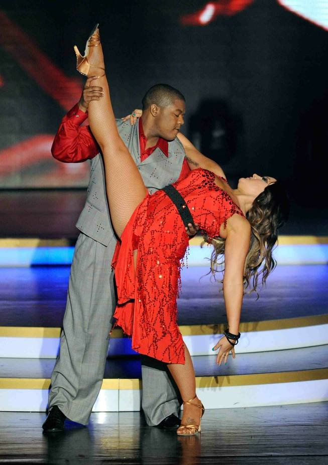 "Kyle Massey and Lacey Schwimmer perform in ""Dancing With the Stars: Live in Las Vegas"" at the Tropicana on Friday, April 13, 2012."