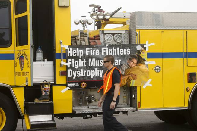 "Firefighters prepare for their fundraiser, ""Fill The Boot,"" on Friday April 13, 2012 at the corner of Rainbow and Flamingo ."