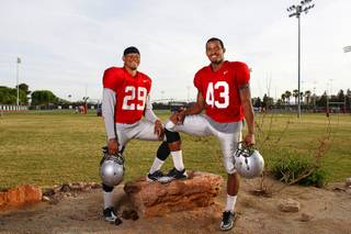 Brothers Tajh Hasson, left, 19, and Tim Hasson, 20, pose after practice at UNLV's Rebel Field Monday, April 16, 2012. Tajh plays strong safety, Tim is an outside linebacker.