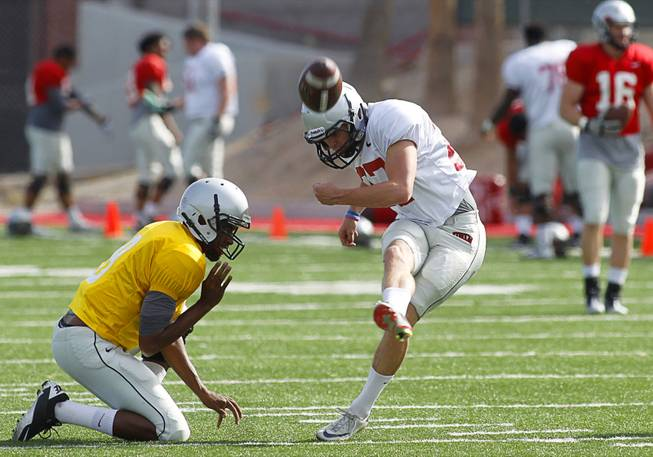 Placekicker Nolan Kohorst (27) kicks during practice at UNLV's Rebel Field Monday, April 16, 2012.