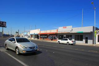 Cars pass a group of store fronts at 1042 S. Main Street which organizers hope to turn into a block of sustainable living type shops Tuesday, April 17, 2012.
