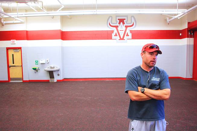 Arbor View head football coach Dan Barnson talks in the school's new weight room Wednesday, April 18, 2012.