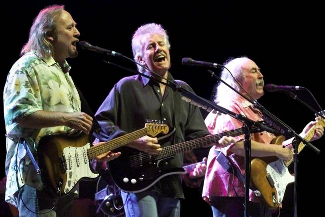 "From left, Stephen Stills, Graham Nash, and David Crosby perform the song ""Carry On"" at the MGM Grand Garden Arena Saturday, February 19, 2000. The band, also playing with Neil Young, is on its first U.S. tour since 1974 to promote the new album ""Looking Forward."""