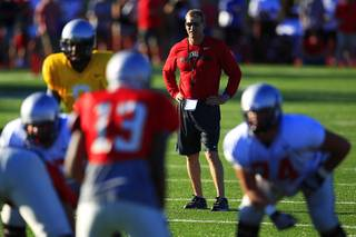 UNLV head coach Bobby Hauck watches his team during the Rebels spring football game Friday, April 20, 2012.