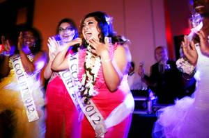 Senior Kiana Spengler, center, reacts to being named prom queen at Mojave High School prom at Aliante Station in North Las Vegas on Saturday, April 21, 2012.