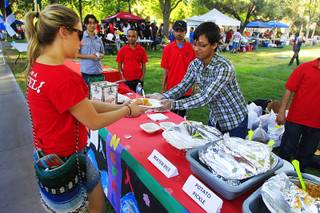 Krishna Shrestha serves Jordyn Hay Nepalese momo dumplings at UNLV's Festival of Communities Saturday, April 21, 2012.