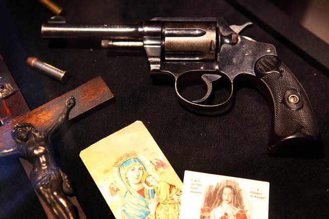 Anthony Spilotro's pistol, bullets, holy cards and crucifix on display at the Mob Attraction Las Vegas at the Tropicana on Monday, April 23, 2012.