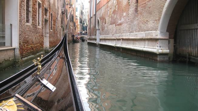 A look from the front of a gondola as we drift through a canal in Venice.
